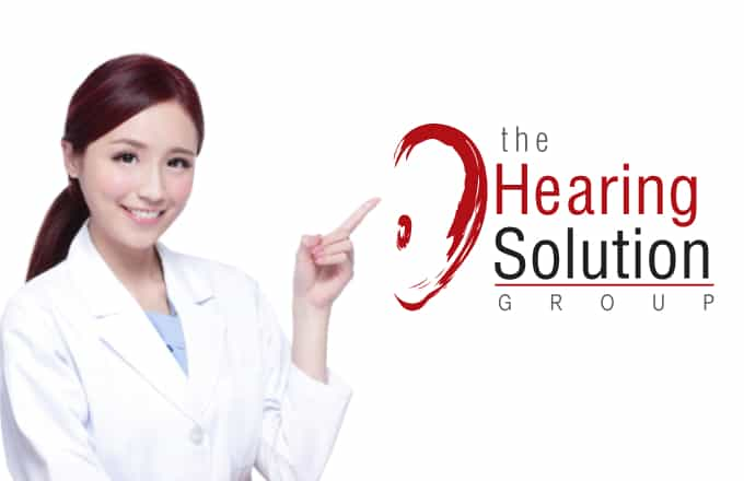 Smiling woman doctor from hearing solution