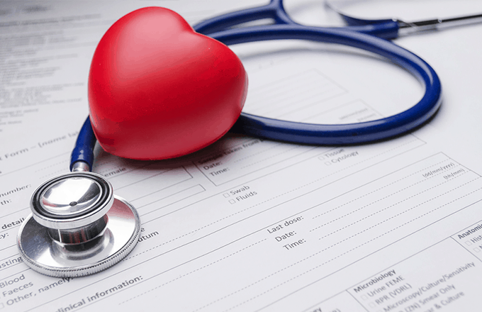 Heart-shaped stethoscope on a form
