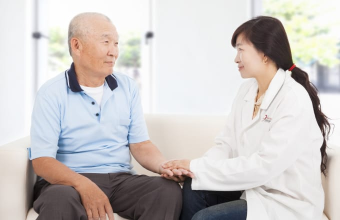friendly hearing solution doctor caring for senior man