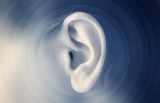 a close up shot of a person's ear