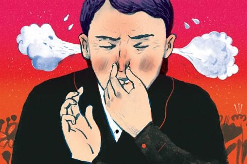 a man pinching his nose when sneezing