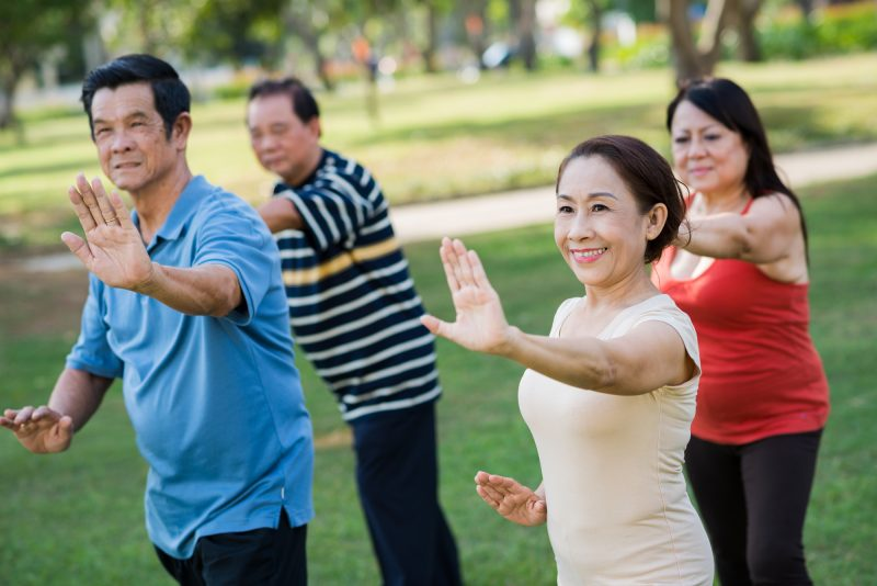 A group of elderly exercising