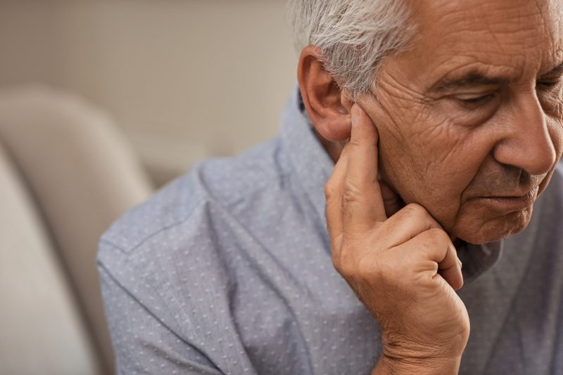 Senior man with hearing loss