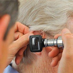 a doctor checking ear condition of a patient 1